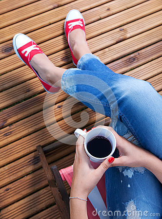 Woman relaxing on a patio