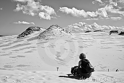Woman relaxing in sand dunes