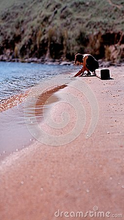 Woman relaxing on sandy beach