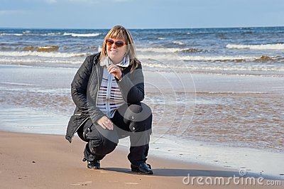 Woman relaxing at the sea.