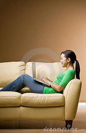 Woman relaxing on sofa in livingroom
