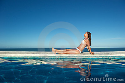 Woman relaxing in the spa swimming pool