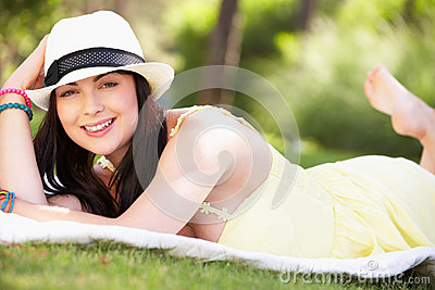 Woman Relaxing In Summer Garden