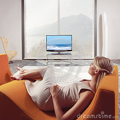 Woman relaxing and watching TV