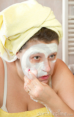 Woman removing mask