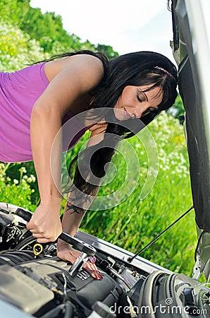Woman repairing broken car