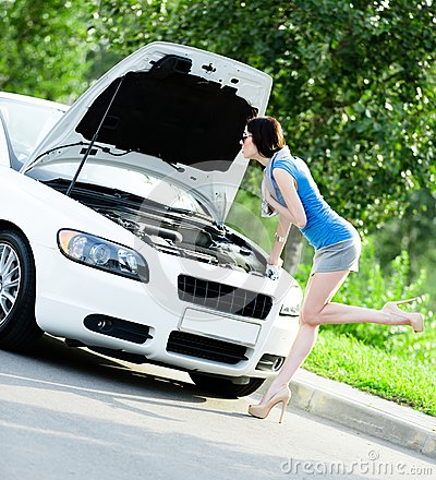 Woman repairing the broken white car
