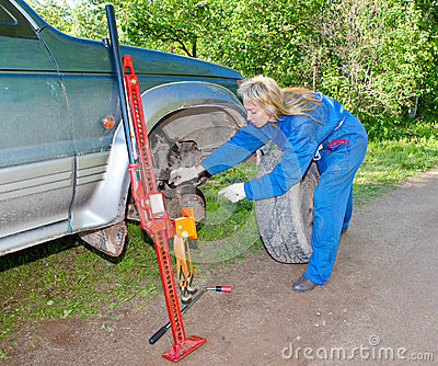 The woman repairs the car