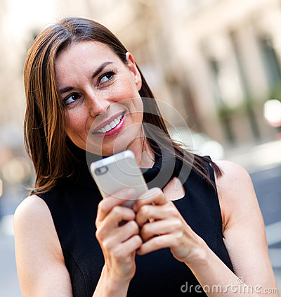 Woman replying a text message