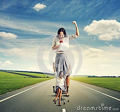 Woman reproaching joyful small woman