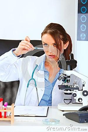 Woman researcher using analyzing sample