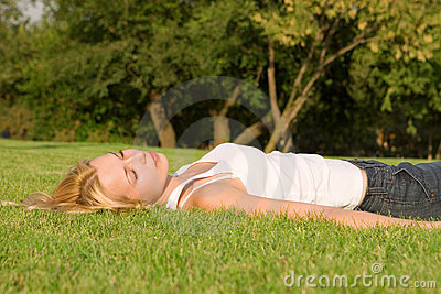 Woman rest on the grass