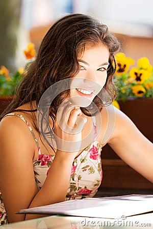 Woman in a restaurant reading menu
