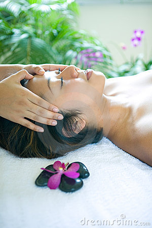 Woman restful while being in head massage