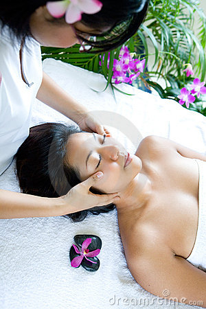 Woman restful while having a facial massage