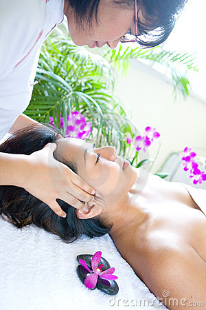 Woman restful while having a facial therapy