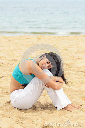 Woman resting alone on beach relax