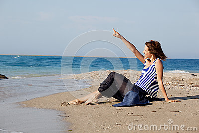 Woman resting on the beach in summer day