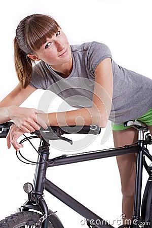 Woman resting on her bike