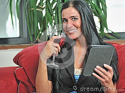 Woman resting in living room drinking wine
