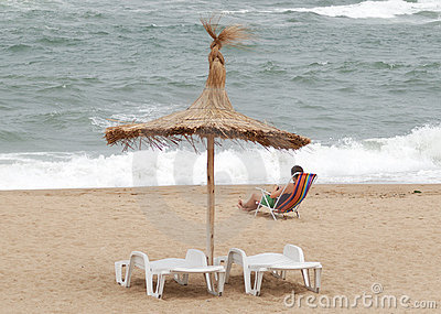 Woman resting near sea shore