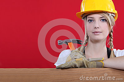 Woman resting on wooden beam