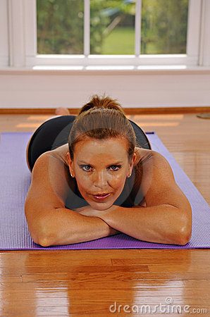 Woman resting on yoga mat