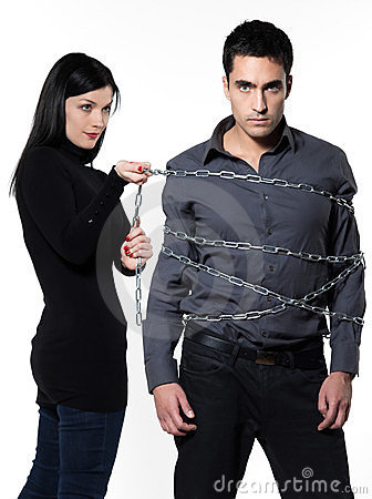 Woman restraining a man chained
