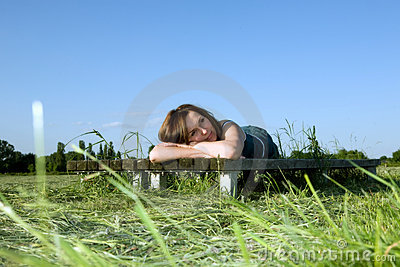 Woman rests on the green grass