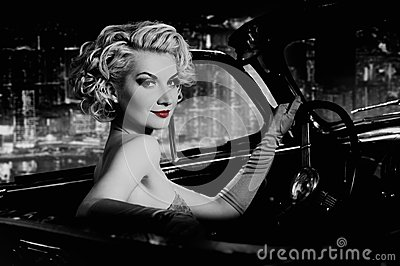 Woman  in retro car against