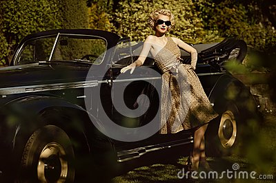 Woman and retro convertible