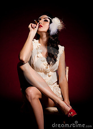 Woman in retro dress with cigar