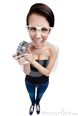 Woman with retro photographic camera