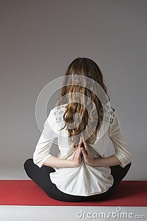 woman in reverse namaste pose during meditation