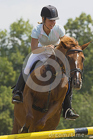 Woman rider in equestrian race jumps Editorial Image