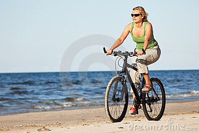 Woman riding bicycle in beach