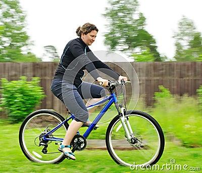 Woman riding the bike