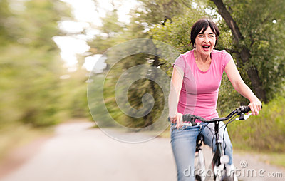 Woman riding bike excited on