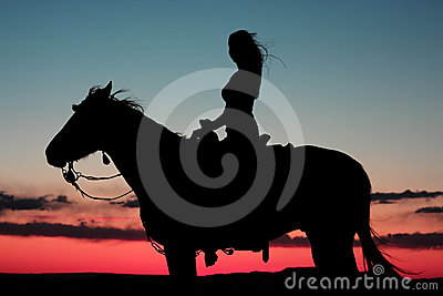 Woman Riding Horse in Brilliant Sunset
