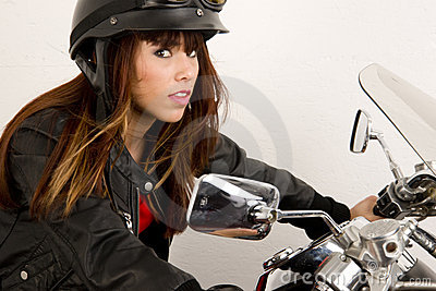 Leather Wearing Woman Riding Motorcycle