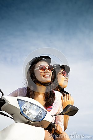 Free Woman Riding Scooter Royalty Free Stock Image - 25636436