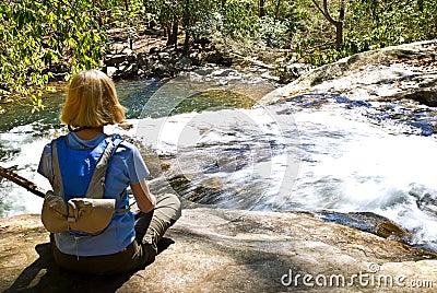 Woman on Rock Top of Waterfall
