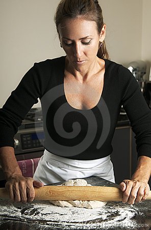 Woman Rolling Dough