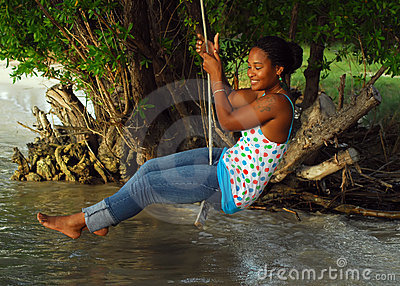Woman on rope swing