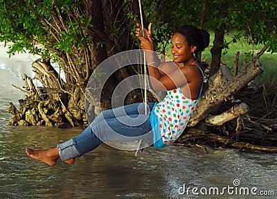 Woman on rope swing