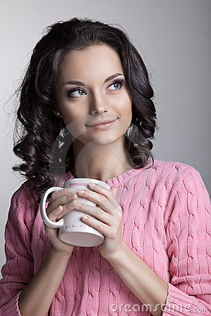 Woman in rose jacket with cup of tea