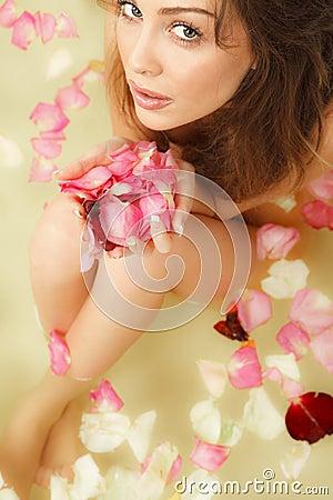 Woman with rose petal
