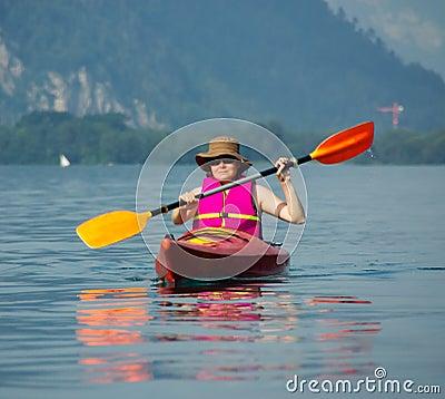 Woman rowing in kayak