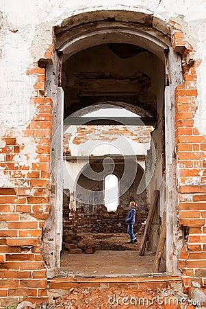 Woman in ruin church