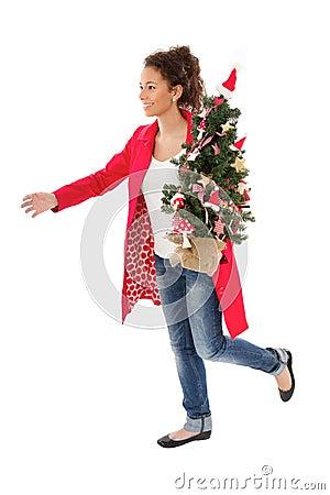 Woman run with Christmas tree